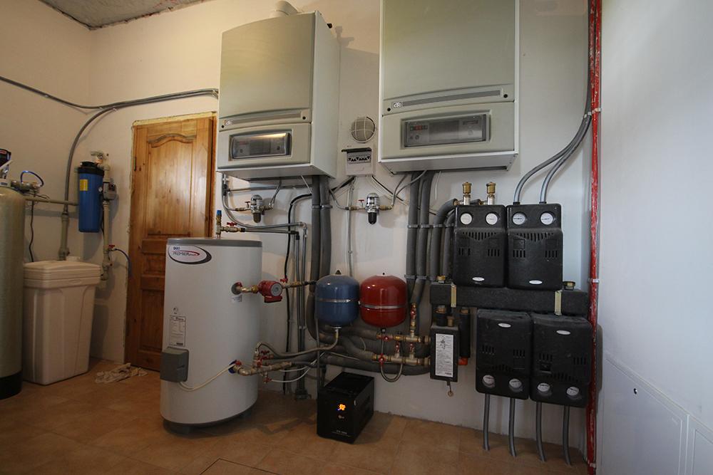 Отопление дома твердотопливным котлом длительного горения